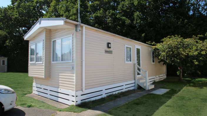 Regal-Regency-preowned-caravan-forest-edge-exterior