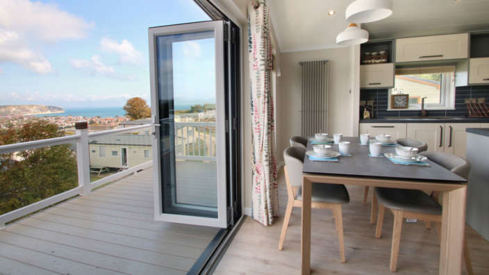 Bifold-doors-open-to-a-panoramic-view-of-Swanage