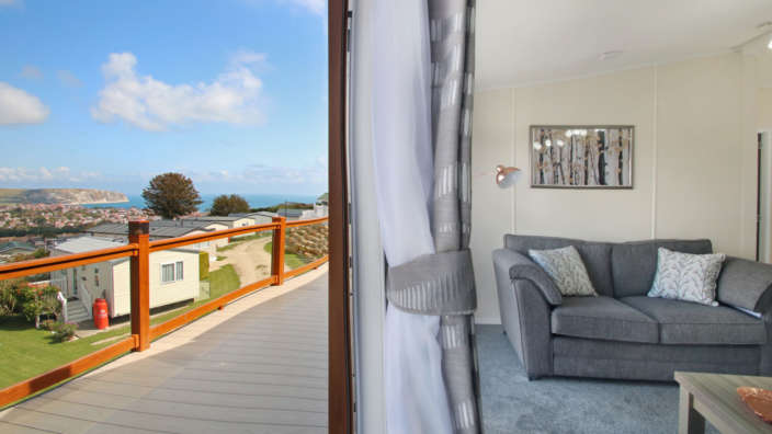 Victory-Parkview-lounge-with-doors-opening-to-decking-and-stunning-views