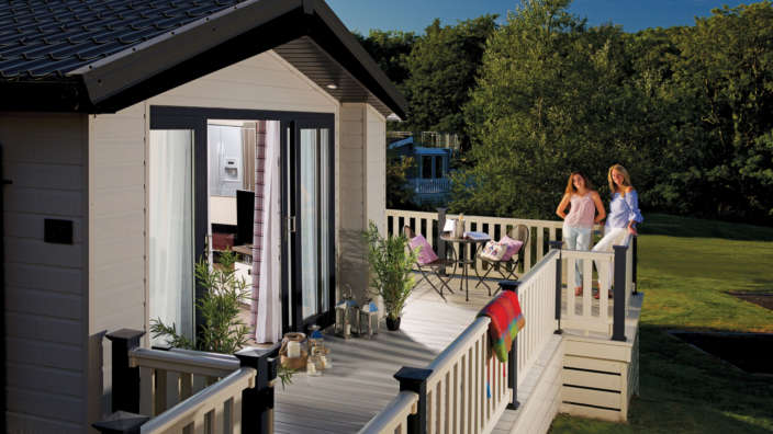 Family on decking of New Forest holiday home 3200x2400