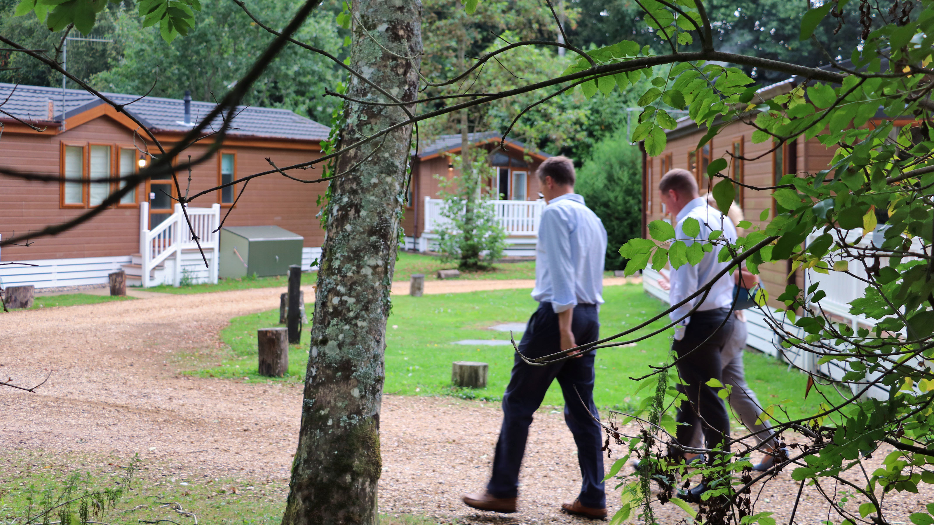 The-group-take-a-stroll-through-the-woodlands-of-Merley-Court-Holiday-Park