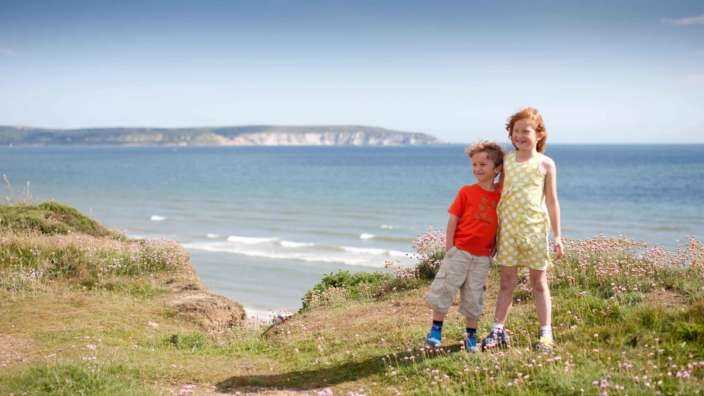 Children at scenic Milford on Sea clifftop with views of the Solent