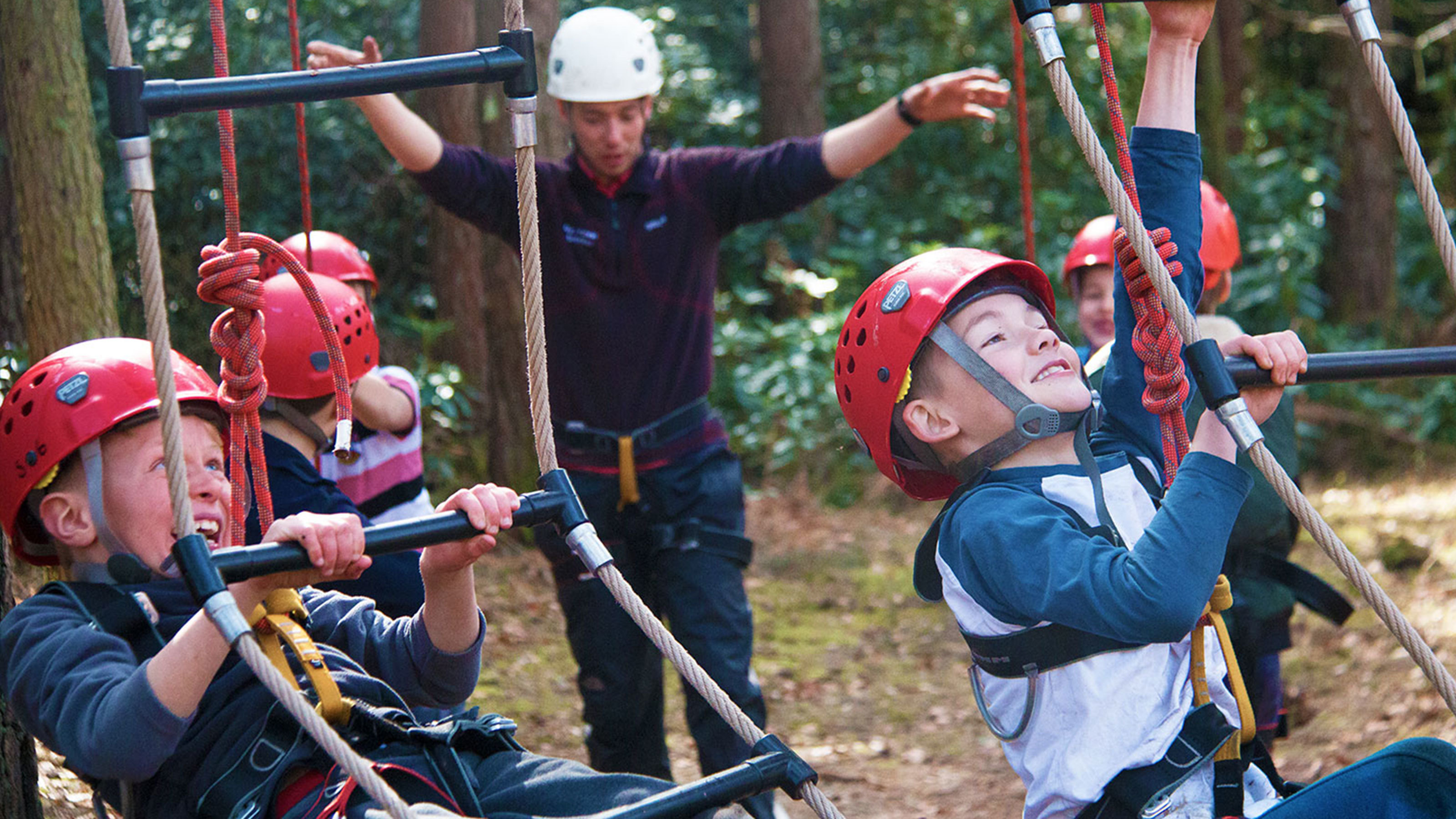 Children-climbing-obstacle-course-at-New-Forest-Activities