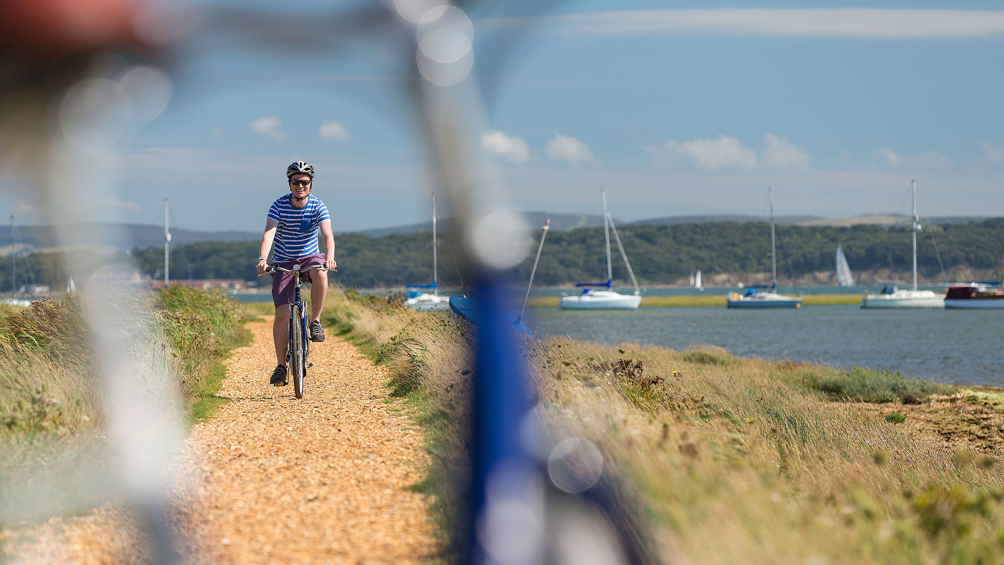 Cyclist-on-hurst-spit-in-the-New-Forest