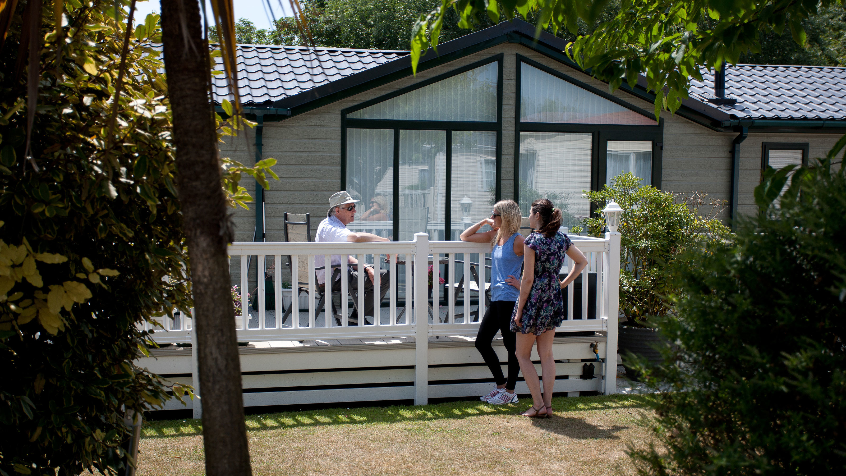 Owners Chatting Decking Safely Distanced