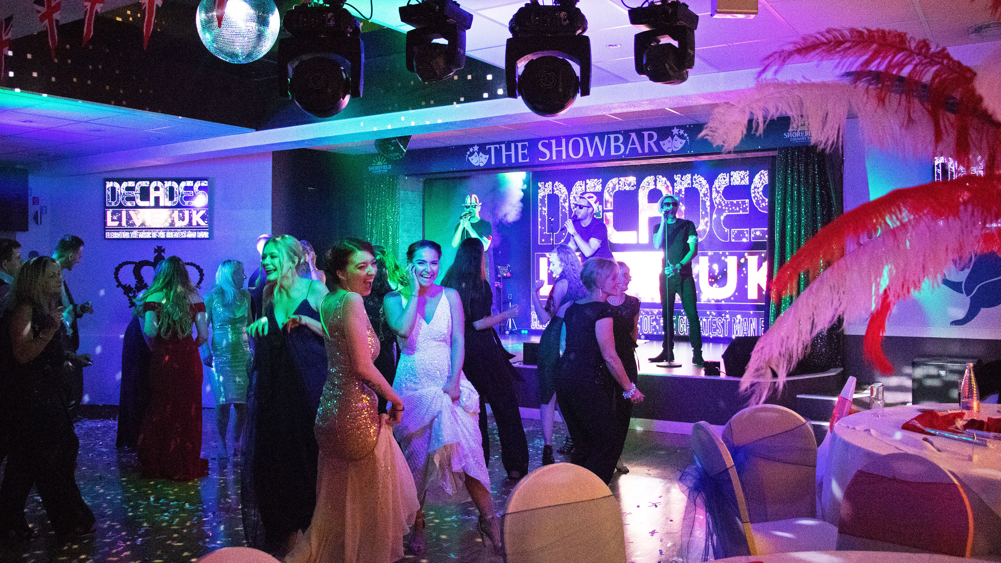 Staff-let-their-hair-down-on-the-dancefloor-to-Decades-Live