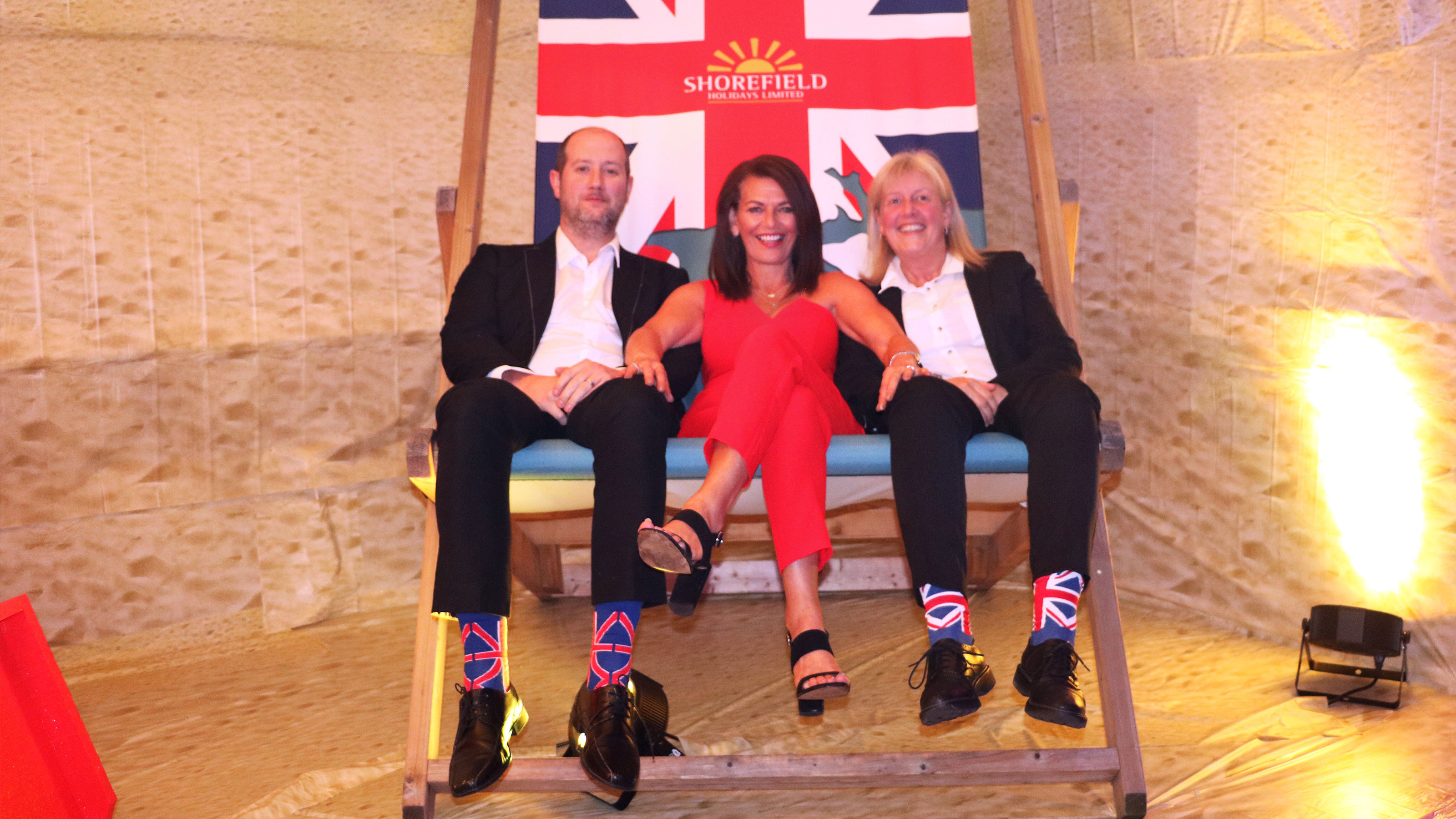 The-proud-organisers-of-the-Staff-Awards-take-a-seat-in-the-giant-deckchair