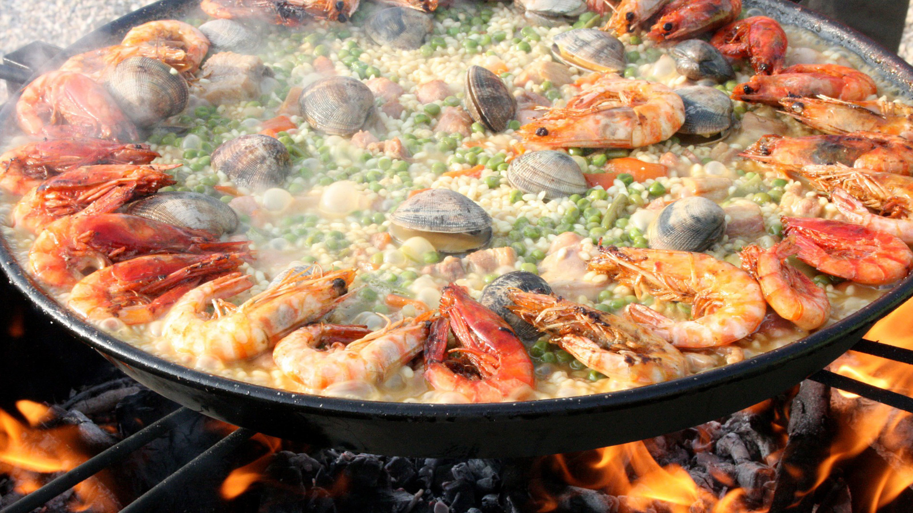 Seafood-paella-cooking-on-an-open-flame