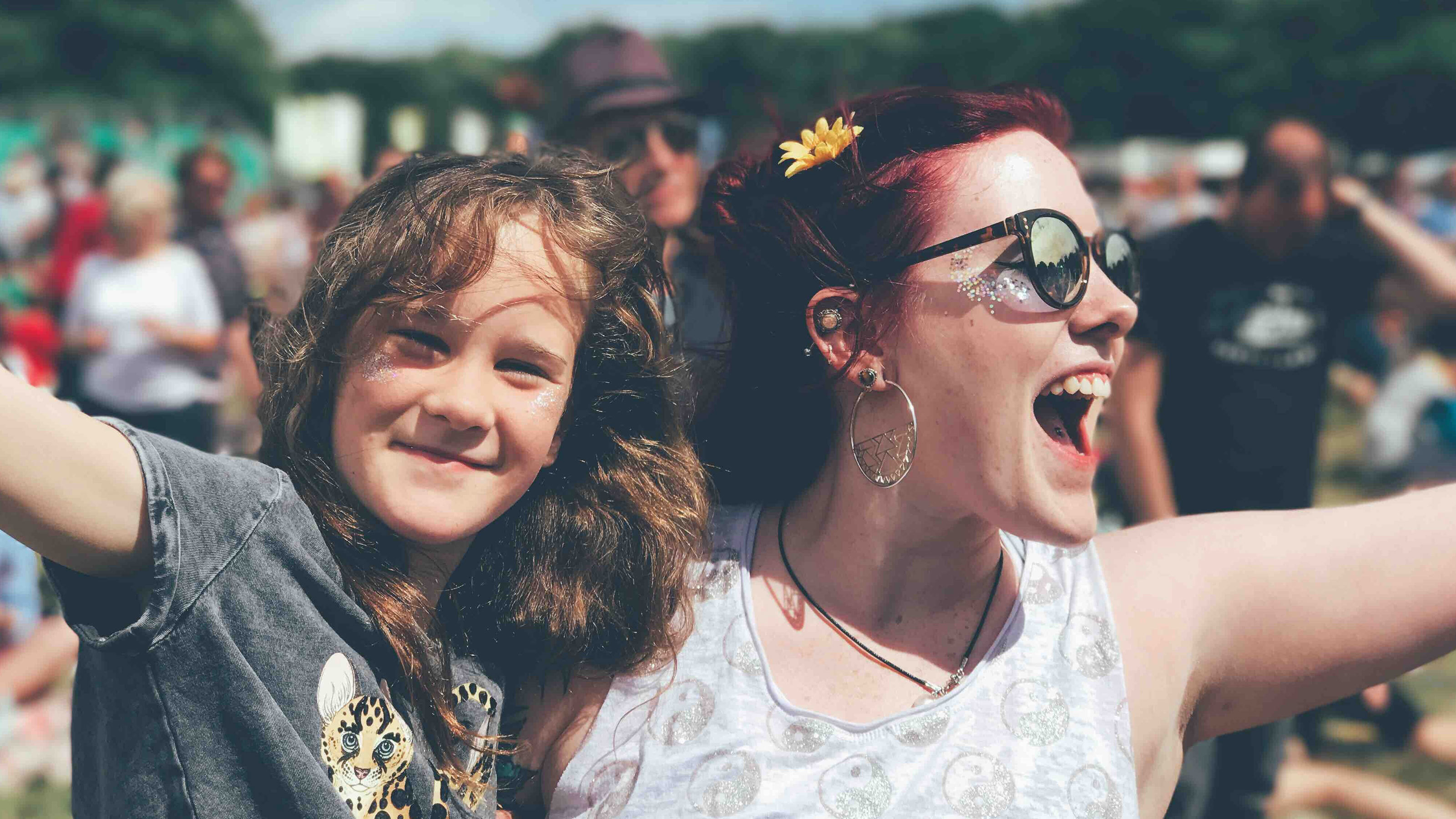 Young-girl-and-a-woman-cheering-at-a-festival