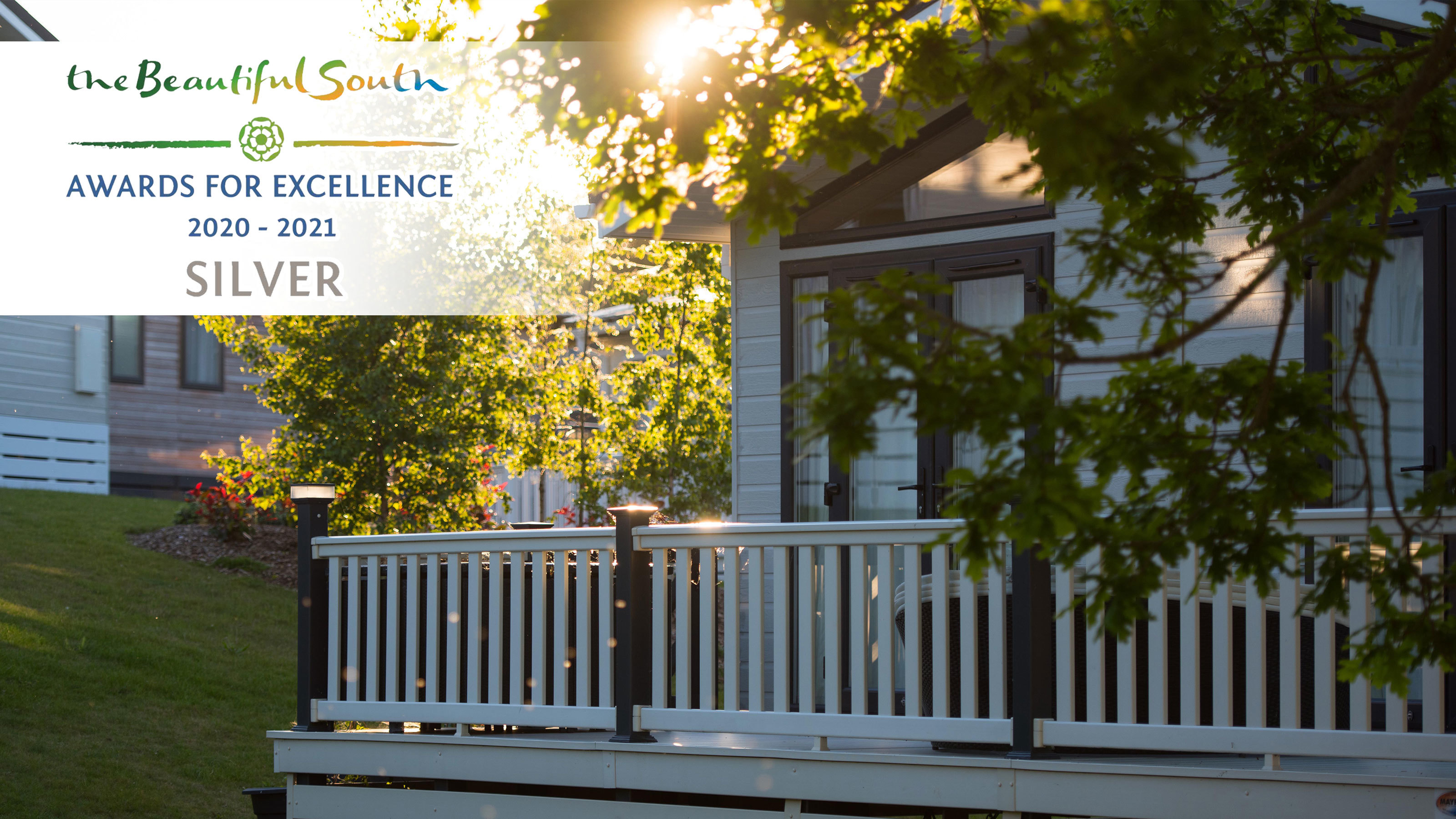 Woodland holiday home at Shorefield Country Park with Beautiful South Awards logo