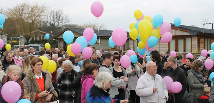 Hannah's holiday home appeal crowd with balloons