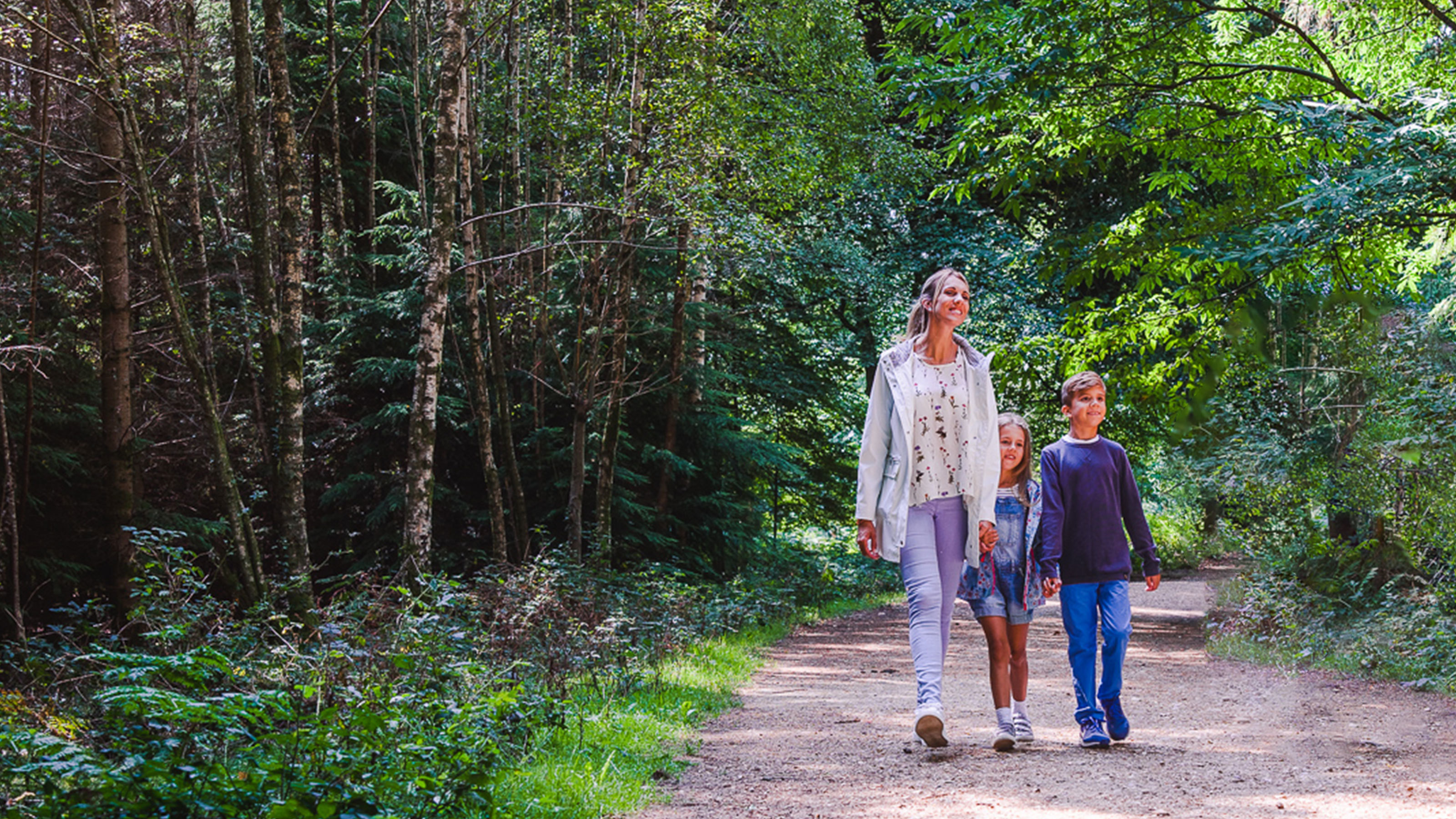 Mother-and-children-walking-through-woodland