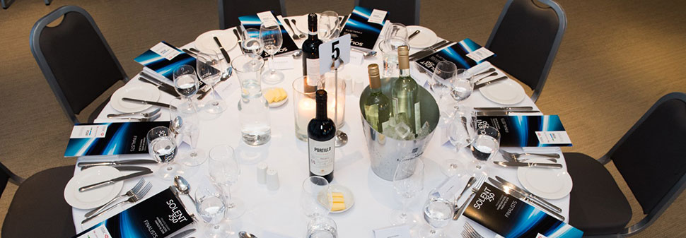 A set table with programmes at the Solent 250 Awards