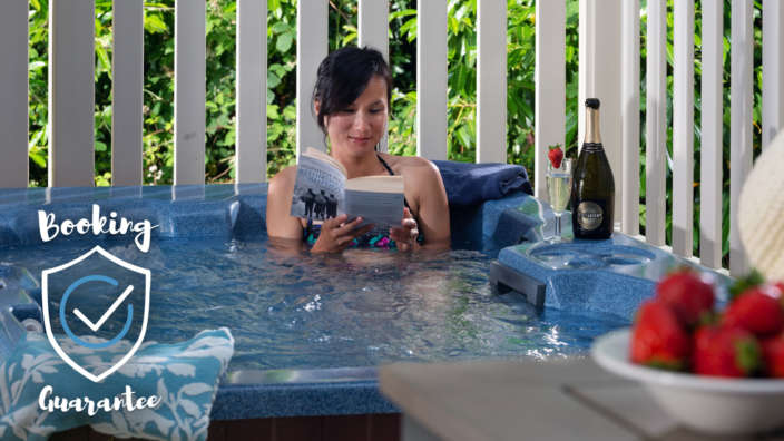 Woman in hot tub booking guarantee