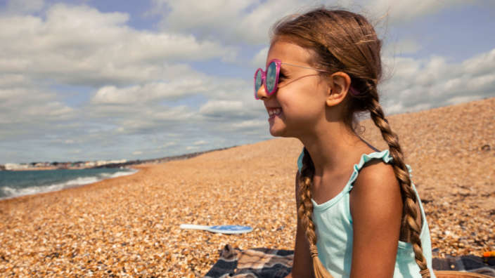 Young girl on Milford on Sea beach in summer