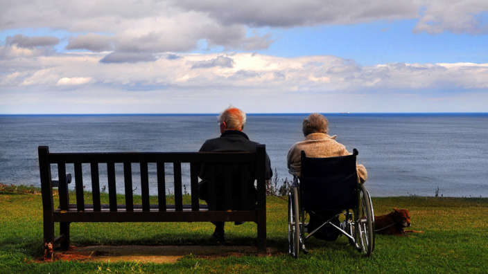 Wheelchair accessible holidays couple at clifftop