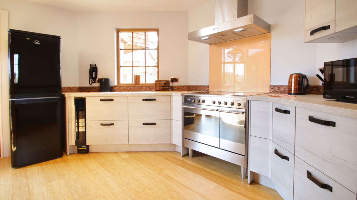 Kitchen with essentials and copper accents in Coppertree House treehouse accommodation