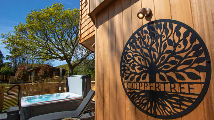 Coppertree house sign treehouse accommodation in the New Forest