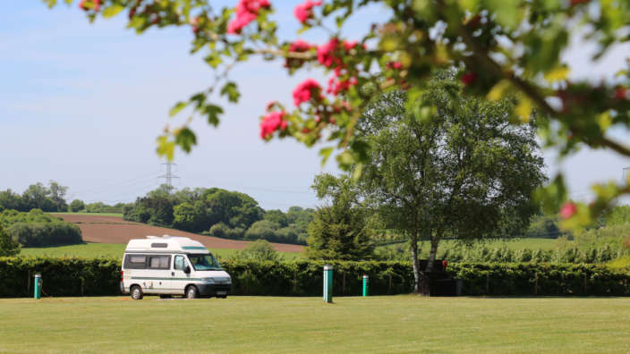 A Campervan On A Serviced Grass Pitch At Wilksworth