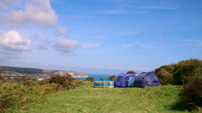 Informal-camping-pitches-with-views-of-Swanage-Bay