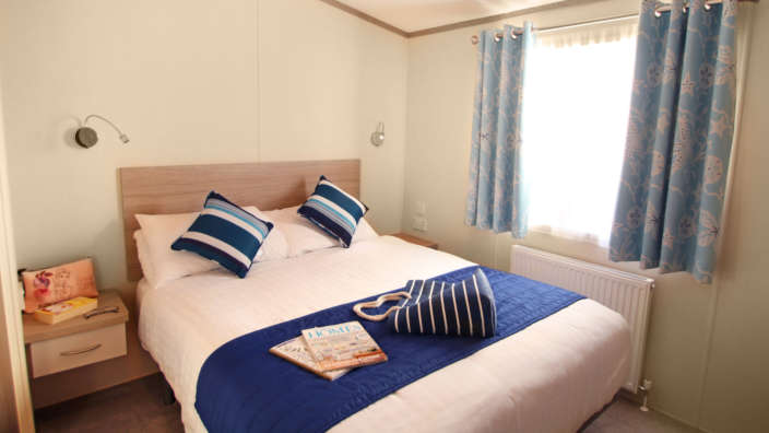Double-bed-in-all-our-caravans-the-sensation-range-at-Oakdene-Forest-Park