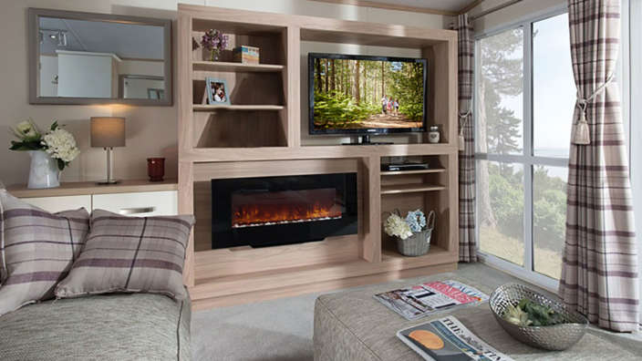 Lounge fireplace in sublime caravans at Forest Edge Holiday Park