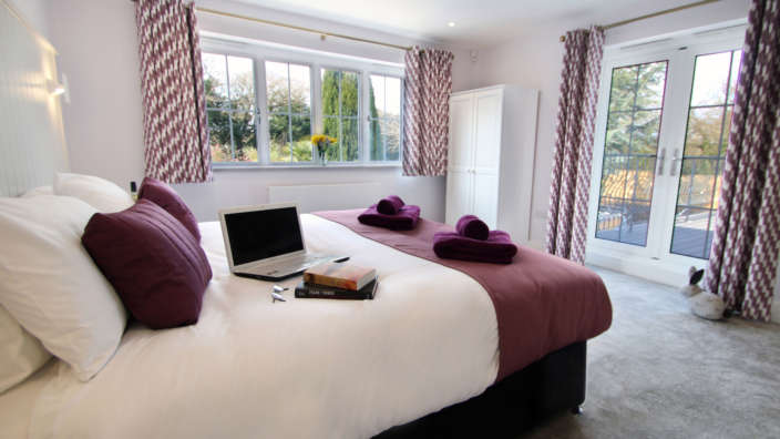 4 Bifold Doors Open To The Balcony From One Of The Master Bedrooms