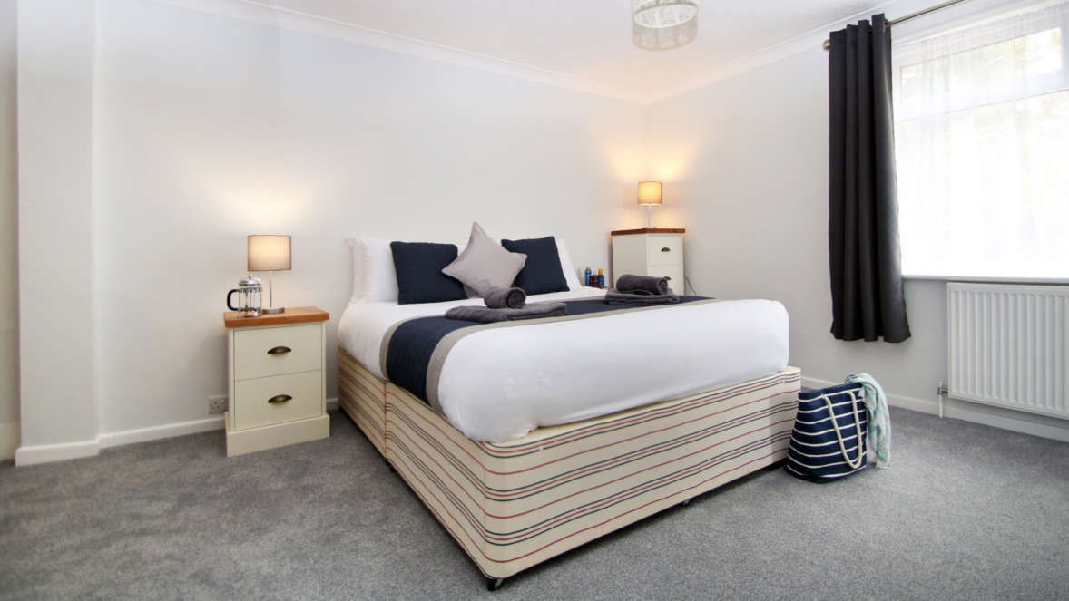 The Burrow master bedroom with double bed