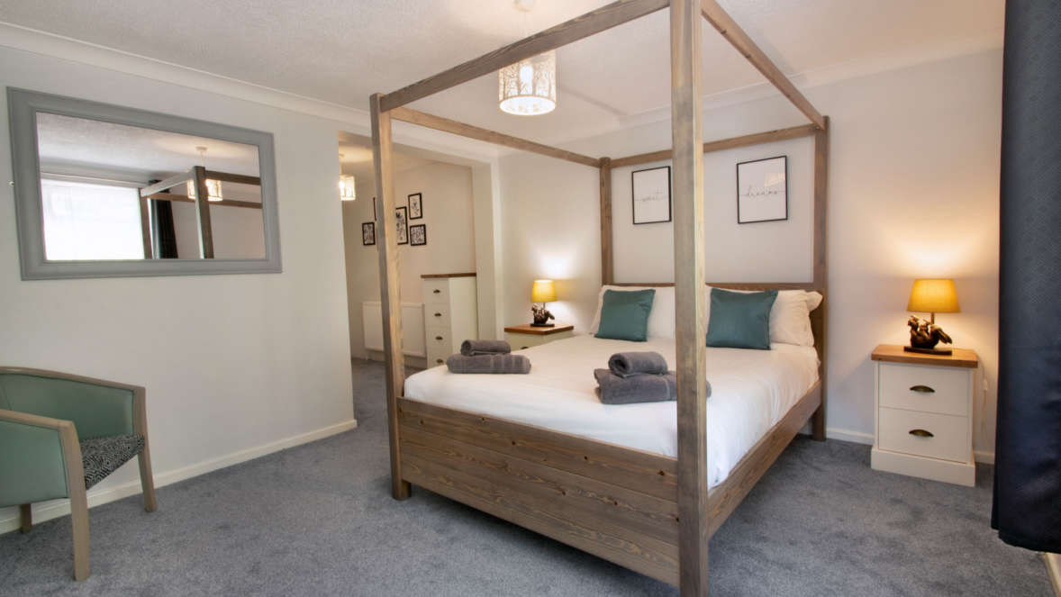 The Burrow master bedroom with four poster bed