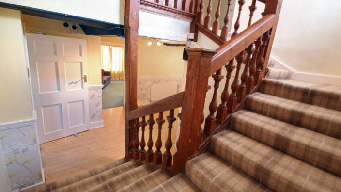 Stunning-feature-staircase-in-Tudor-Rose-House