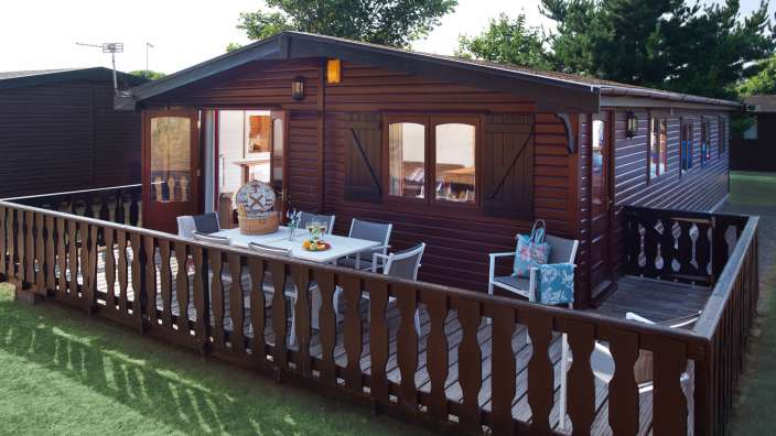 1 Spacious Decked Outdoor Area With Furniture On A Select Lodge