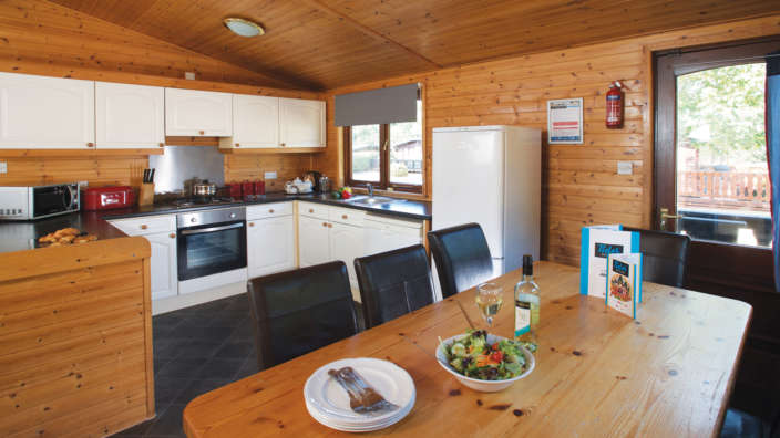 3 Dining Area And Kitchen In A Select Lodge