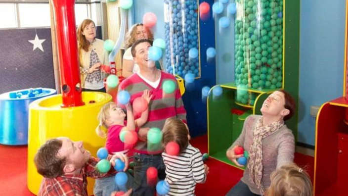 Family-playing-inside-Georges-Spaceship-Playzone