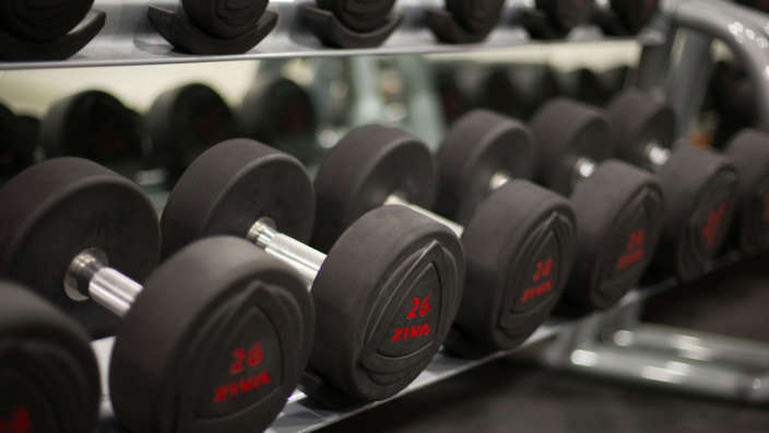 3 Dumbells In The Fitness Club