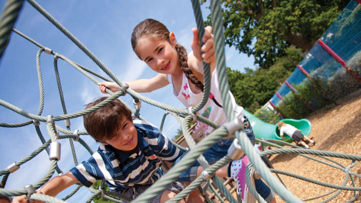 2  Kids Playing On The Outdoor Climbing Frame