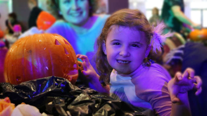 Girl-enjoying-pumpkin-carving
