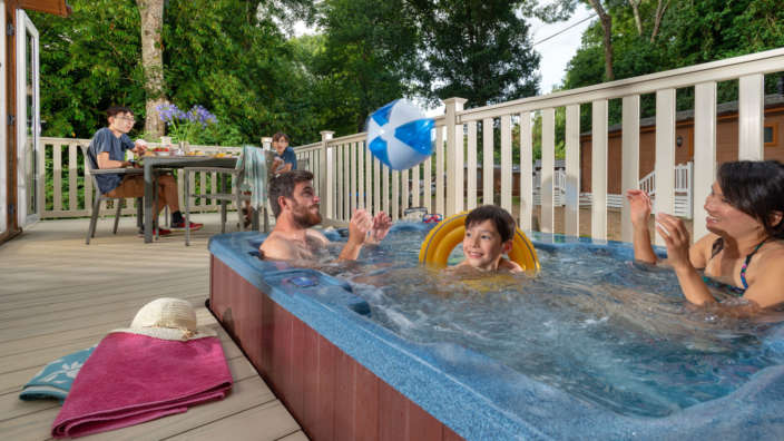 A-family-play-catch-with-a-beach-ball-in-a-hot-tub