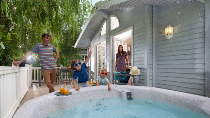 Two-children-cheerily-splash-around-a-hot-tub