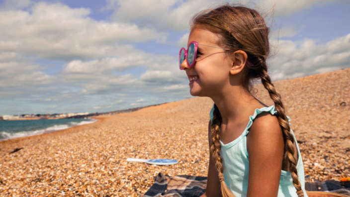 Happy Young Girl On Beach