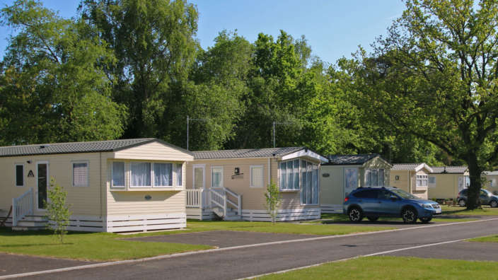 3 Caravans In Summer At Forest Edge