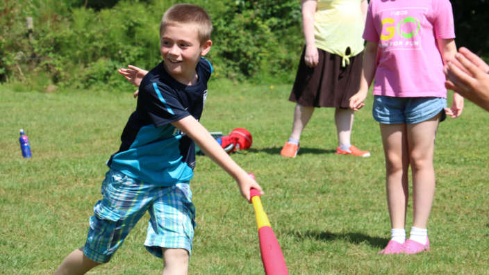 3 Boy Playing Rounders In Summer