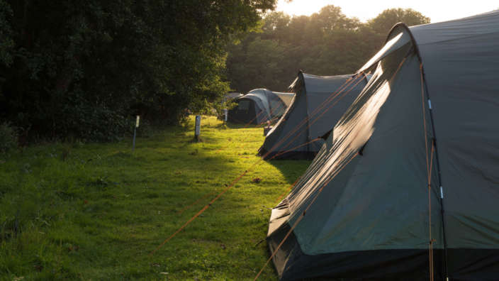 4 Tents Grass Pitch Sunset