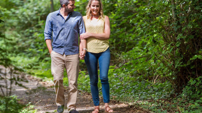 3 A Couple Walking Through The Leafy Woods