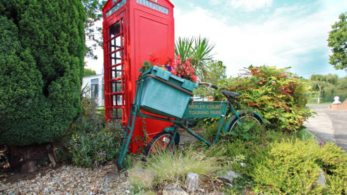 Merley Court Holiday Park scenery and telephone box