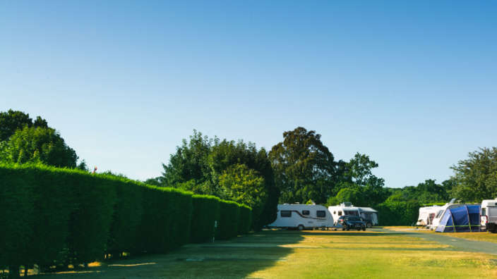 Motorhomes camping at Merley Court Holiday Park