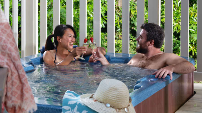 Review Couple in hot tub at Merley Court Holiday Park