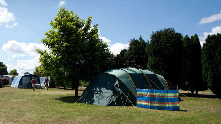 2 Tent Pitched On Grass