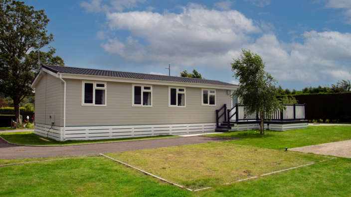 Superior Lodge in parkland setting at Merley Court Holiday Park