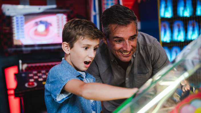 Arcade Machine Playing Family
