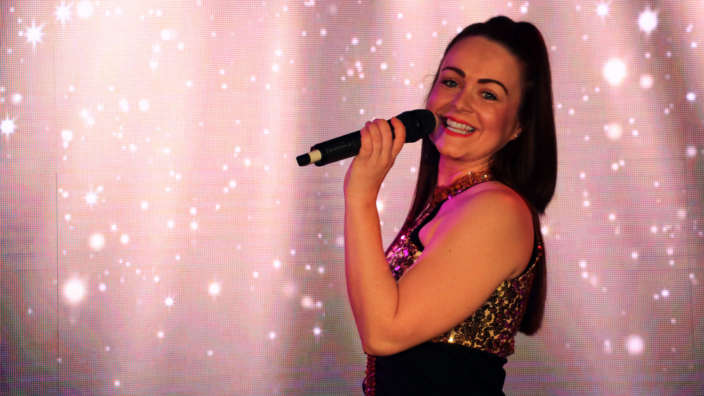 Singer-performing-on-stage-at-Shorefield-Country-Park